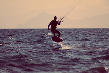 Man Kite Surfing Over The Sea ...
