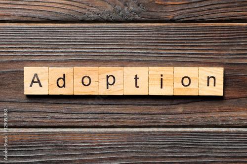 Photo adoption word written on wood block