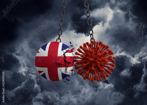 Fototapeta Virus microbe smashing into United Kingdom flag ball. 3D Render