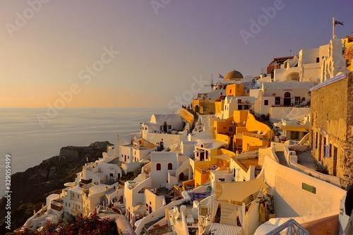 Fototapeta The sun sets in Santorini obraz