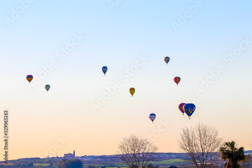 Aerostatic Balloons flying in Seville in the aerostatic balloon race of 2020 Canvas Print