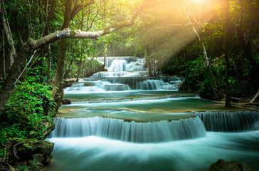Panel Szklany Wodospad Beautiful waterfall with sunlight in autumn forest at Erawan National Park, Thailand, Nature landscape , Beautiful steam green forest nature