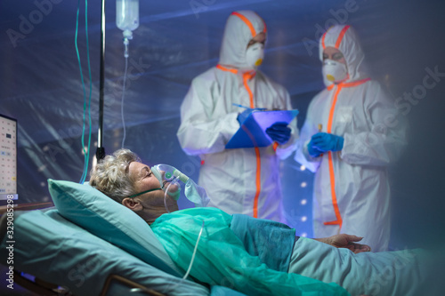 Infected patient in quarantine lying in bed in hospital, coronavirus concept. - 329085298