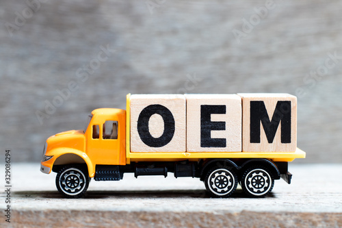 Truck hold letter block in word OEM (Abbbreviation of Original Equipment Manufac Canvas Print
