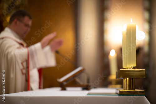 Fotografia Priests during a mass/wedding ceremony/nuptial mass (shallow DOF; color toned im