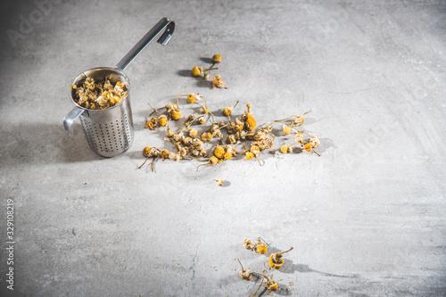 Chamomile tea dried petals - loose flowers on infuser Fototapeta