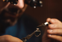 Jeweler Working With Ring On B...