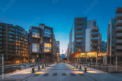Oslo, Norway. Night View Of Residential Multi-storey Houses In Aker Brygge District. Summer Evening. Residential Area. Famous And Popular Place