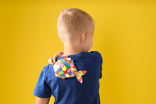 Little Boy With Paper Fish On ...
