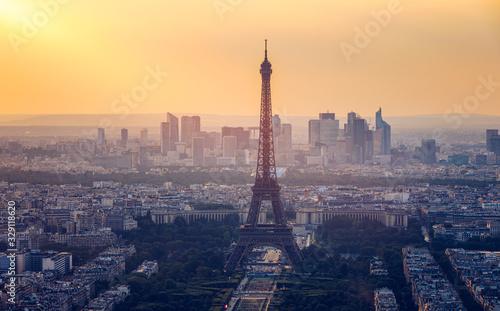 Fototapeta Panoramic aerial view of Paris, Eiffel Tower and La Defense business district. Aerial view of Paris at sunset. Panoramic view of Paris skyline with Eiffel Tower and La Defense. Paris, France. obraz na płótnie