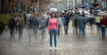 The Young Girl Stands On The Crowded Urban Street