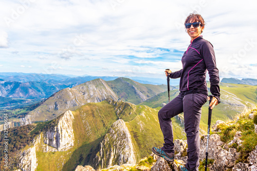Monte Txindoki, Guipuzcoa / Spain »; Spring 2018: A young woman with canes on top of Mount Txindoki