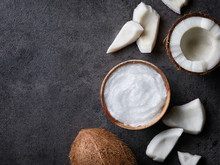 Bowl Of Coconut Oil And Fresh Coconut