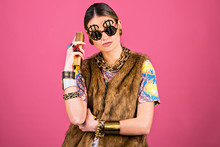 Upper Class Concept, Wealthy Rich Young Woman, Fashion Style, Close Up Holding  Gold  Bars, Funny  Self-confident Attitude With Copy Space.