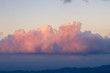 Leinwandbild Motiv isolated pink cumulus congestus cloud in a warm sky