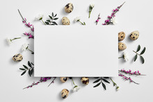 Creative Easter Flat Lay With White Paper Blank