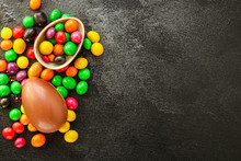 Chocolate Egg And Candy Happy  Easter Decor. Menu Concept Background. Top View. Copy Space