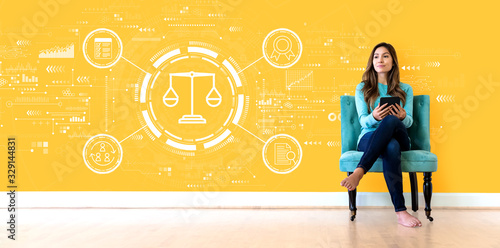 Legal advice service concept with young woman holding a tablet computer Wallpaper Mural