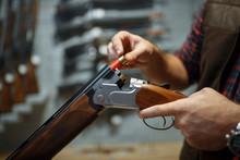 Man Loads A Rifle, Gun Shop In...