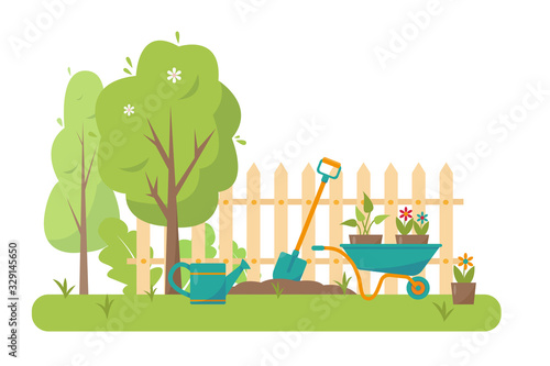 Fototapeta Gardening tools and trees in garden. obraz