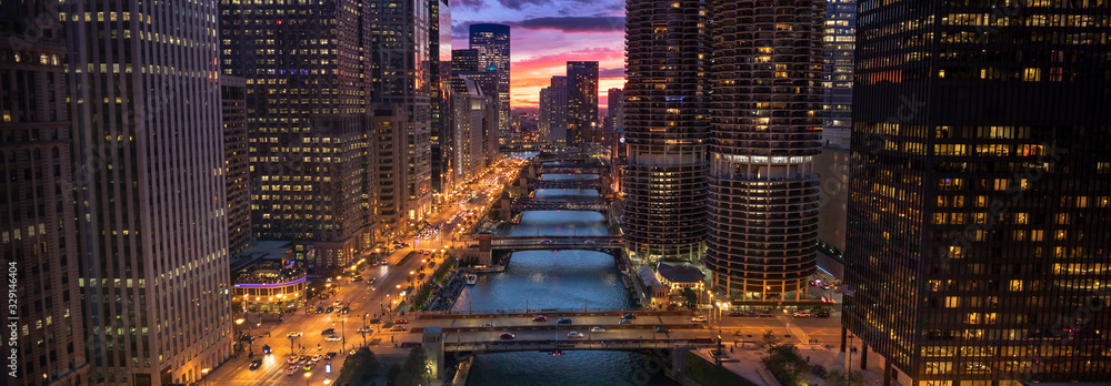 Fototapeta Downtown city buildings and skyline over the Chicago River Illinois USA