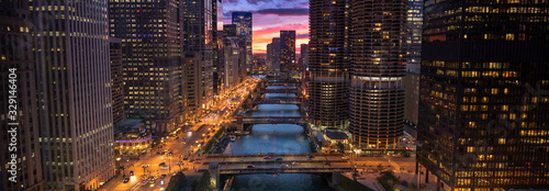 Downtown city buildings and skyline over the Chicago River Illinois USA