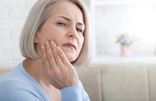 Teeth Problem. Woman Feeling T...