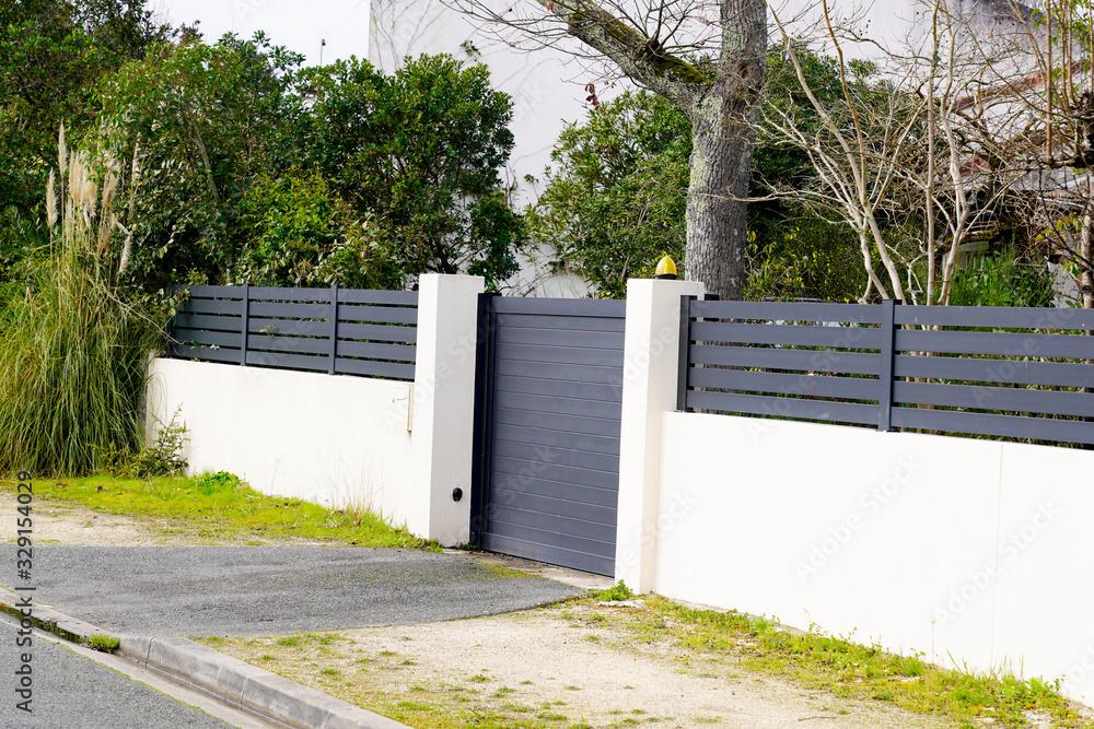 Fototapeta gray suburb metal aluminum house gate and slats
