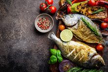 Baked Dorado Fish, Sea Bream With Grilled Vegetables, Herbs And Seasonings, Top View