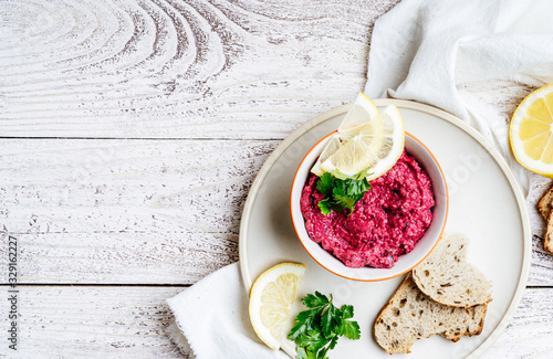 Fotografie, Obraz Beetroot horseradish  hummus served with whole grain bread