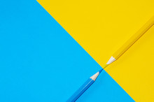 Yellow And Blue Pencil Facing ...