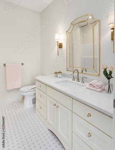Fototapeta Bathroom in luxury home with vanity, mirror, sink, and tile floor obraz