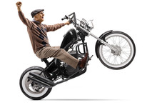 Senior Man Lifting A Motorbike...