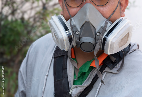 Valokuva Part of human face in multi-purpose respirator half mask with chemical protectiv