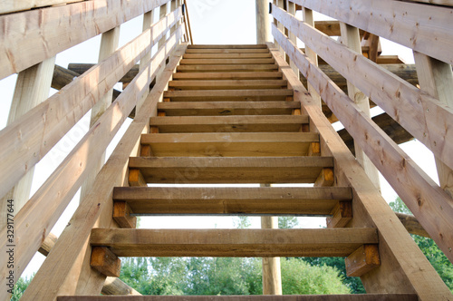 Canvastavla new wooden staircase outdoors in summer day, symbolizing career advancement and