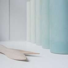 A Row Of Ceramic Blue Vases