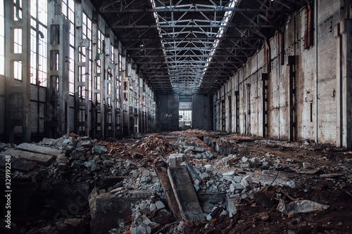 Abandoned large industrial hall with garbage waiting for demolition Wallpaper Mural