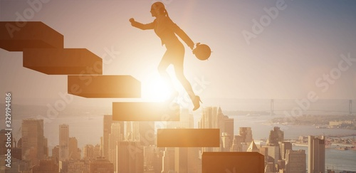 Fototapeta Businesswoman in career growth concept with stairs obraz
