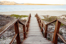 Wooden Stairs Down To Sand Beach