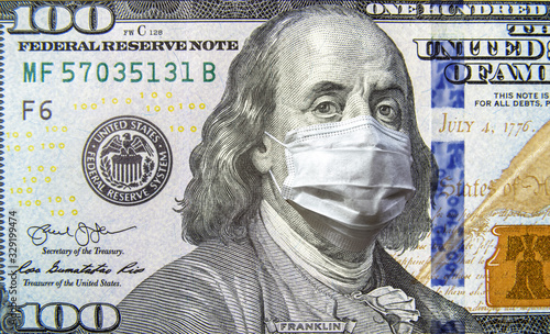 COVID-19 coronavirus in USA, 100 dollar money bill with face mask. Coronavirus affects global stock market. - 329199474