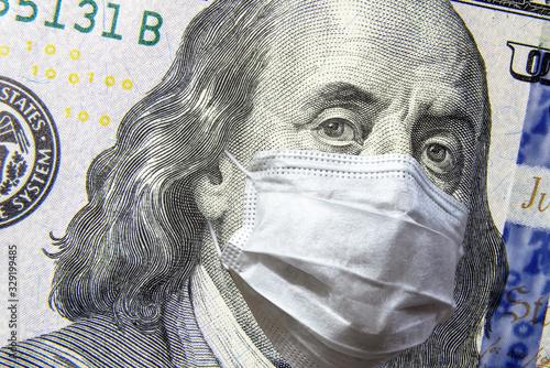 Photo COVID-19 coronavirus in USA, 100 dollar money bill with face mask
