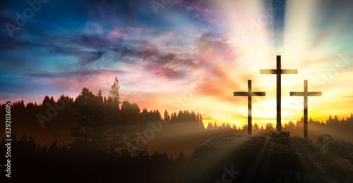 Obraz na plátně three crosses on the rock at sunset