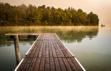 Misty Morning Pier At The Lake