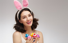 Young Woman With Colorful Eggs