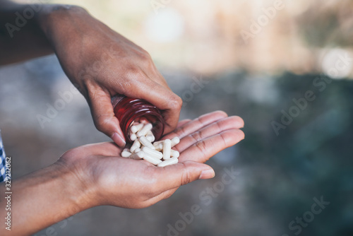 Photo Pills and medicine in woman hands, Hazardous drugs have adverse effects on health