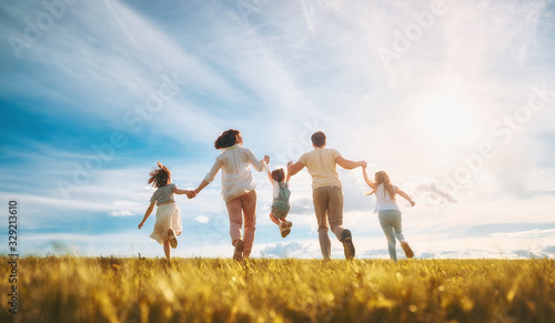 Obraz Happy family on summer walk - fototapety do salonu