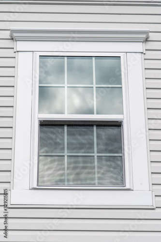 Photo Stand alone double hung window with fixed top sash and bottom sash that slides u