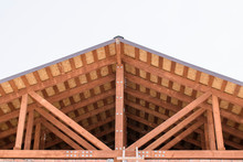 Wooden Roof Without A Crossbar. Vertical Rack, Inclined Struts, Rafters And Lathing. OSB And Metal Bolts With Nuts. Low-rise Construction Concept.