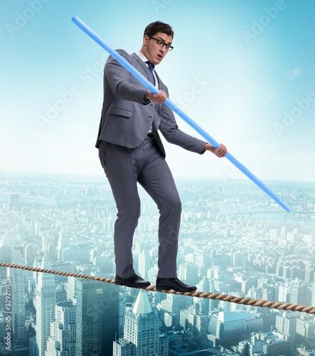 Fotografía Businessman doing tightrope walking in risk concept