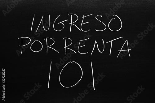 The words Ingreso Por Renta 101 on a blackboard in chalk Wallpaper Mural